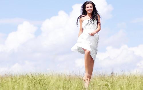 Happy-Girl-In-White-Dress-In-Field-i.jpg