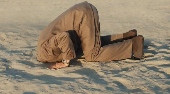 homem areia.jpg