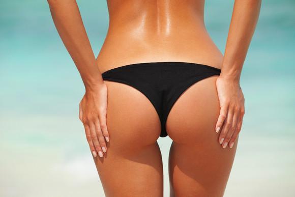 bigstock-Sexy-woman-buttocks-on-the-bea-53109523.j
